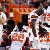 Group of Browns players kneel in prayer during national anthem